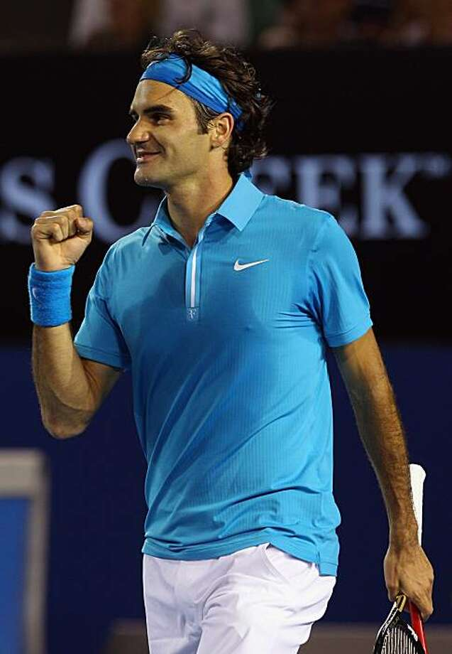 MELBOURNE, AUSTRALIA - JANUARY 29:  Roger Federer of Switzerland celebrates after winning his semifinal match against Jo-Wilfried Tsonga of France during day twelve of the 2010 Australian Open at Melbourne Park on January 29, 2010 in Melbourne, Australia. Photo: Quinn Rooney, Getty Images