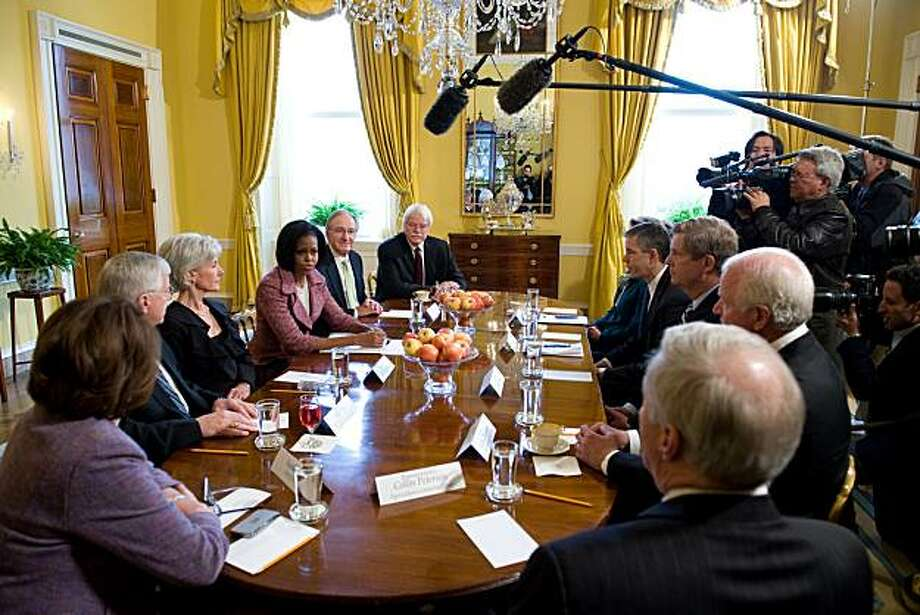 US First Lady Michelle Obama (center L) speaks on childhood obesity and steps families, schools and communities can take to fight it, during a meeting with Cabinet and Congressional members in the Old Family Dining Room of the White House in Washington, DC, February 2, 2010. Photo: Saul Loeb, AFP/Getty Images