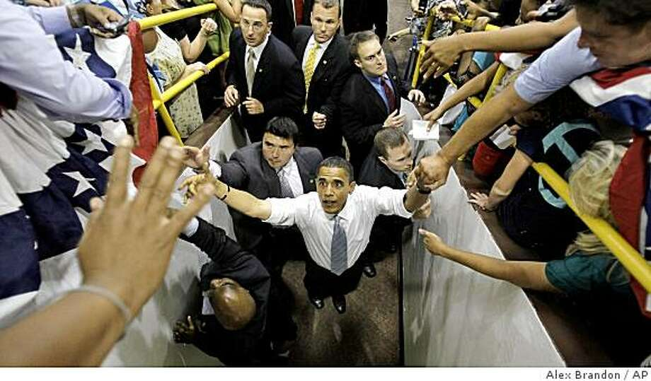 Democratic presidential candidate Sen. Barack Obama, D-Ill., shakes hands after a town hall-style meeting at Baldwin-Wallace College in Berea, Ohio, Tuesday, Aug. 5, 2008.  (AP Photo/Alex Brandon) Photo: Alex Brandon, AP
