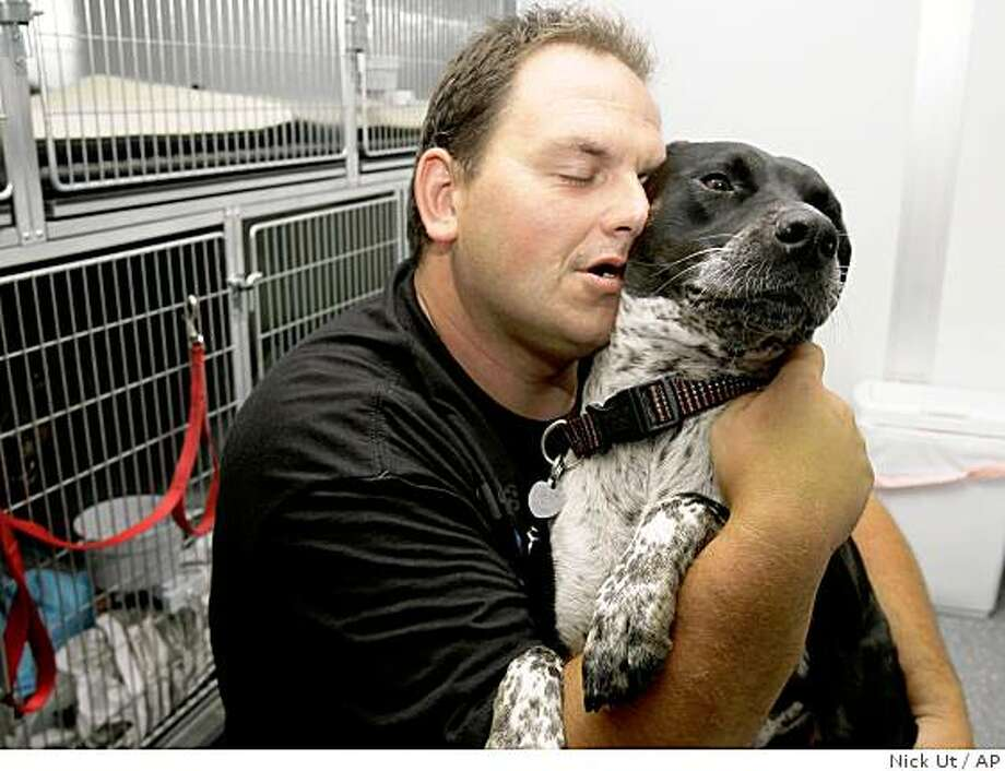 Jon Earl Blake, a homeless man from Oregon, hugs his dog Hannah at a homeless shelter dubbed PetCo Place that accommodates the homeless and their pets, Monday, Aug. 4, 2008, in Hollywood section of Los Angeles. (AP Photo/Nick Ut) Photo: Nick Ut, AP