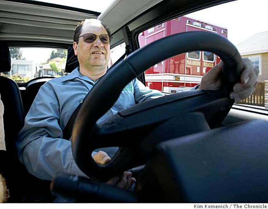 Marc Korchin, owner of Green Motors in Berkeley, Calif., drives the new Zenn car in Berkeley on Wednesday, July 23, 2008.Photo by Kim Komenich / The Chronicle Photo: Kim Komenich, The Chronicle