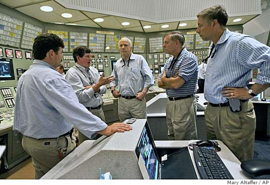 ** CORRECTS SPELLING OF NUCLEAR PLANT NAME ** Republican presidential candidate, Sen. John McCain, R-Ariz., center, Sen. Lyndsey Graham, R-S.C., second from right,  and Rep. Fred Upton, R-Mich., right, are given a tour of the Enrico Fermi Nuclear Plant control room by Chairman and Chief Executive Officer Anthony F. Earley Jr. second from left, and Operations Shift Manager Phil Skarbek, Tuesday, Aug. 5, 2008, in Newport, Mich.  (AP Photo/Mary Altaffer) Photo: Mary Altaffer, AP