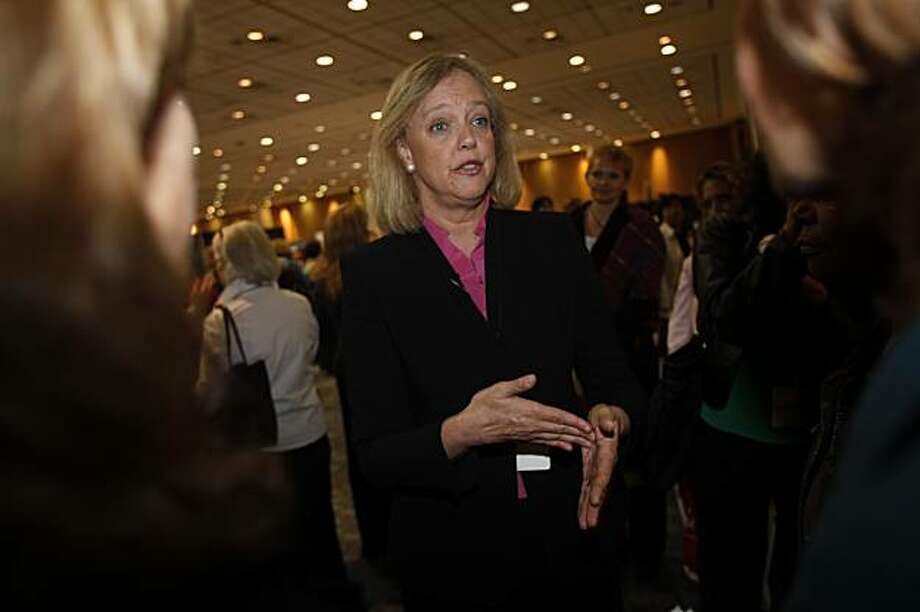 Meg Whitman, former CEO of eBay and candidate for governor, talks to people at the Meg 2010 booth before giving a keynote at the 20th Annual Conference of the Professional Business Women of California at Moscone Center on Wednesday May 6, 2009 in San Francisco, Calif. Photo: Lea Suzuki, The Chronicle