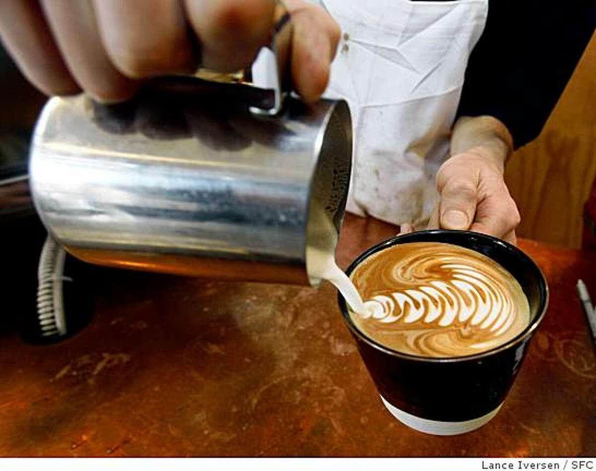 WHATS16_043.JPG A Latt� is poured for a customer at Piccino, a cafe in Dogpatch at 801 22nd Street in San Francisco, Piccino is part of a trend of serving more upscale coffee. They have their own blend by local roaster Blue Bottle Coffee Co. Lance Iversen/San Francisco Chronicle (cq) SUBJECT 01/09/08, SAN FRANCISCO Ca.