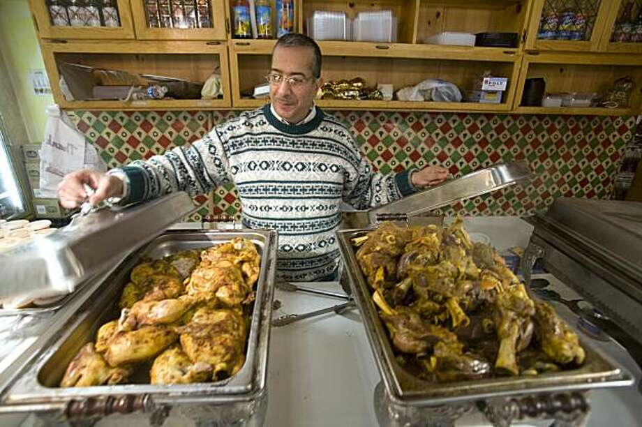 "Osman Othman, owner of the newly opened Oasis Market in Oakland, Calif. opens a Lebanese buffet in his store on Friday, Jan. 22, 2009.   Oasis Market attracts many Middle Eastern immigrants who live in the local ""Koreatown"" neighborhood.  Oakland gave the Koreatown merchants group $12,000 last year to put up ""Oakland's Got Seoul"" banners, but when residents noted few actual Koreans live in Koreatown, the group asked for - and got - another $5,000 to take the banners down. Photo: Adam Lau, The Chronicle"