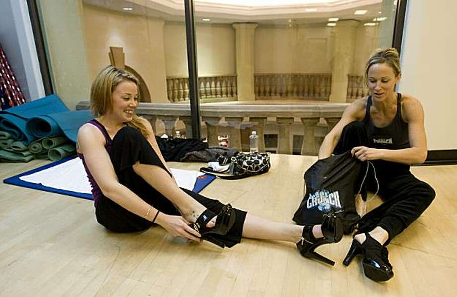 Brooke Marshall and Mindy Kreis, from left, strap on their high heels in during a Stilleto Strength class at Crunch Gym in Blackhawk, Calif. called Stilleto Strength on Monday, Jan. 13, 2010. Photo: Adam Lau, The Chronicle