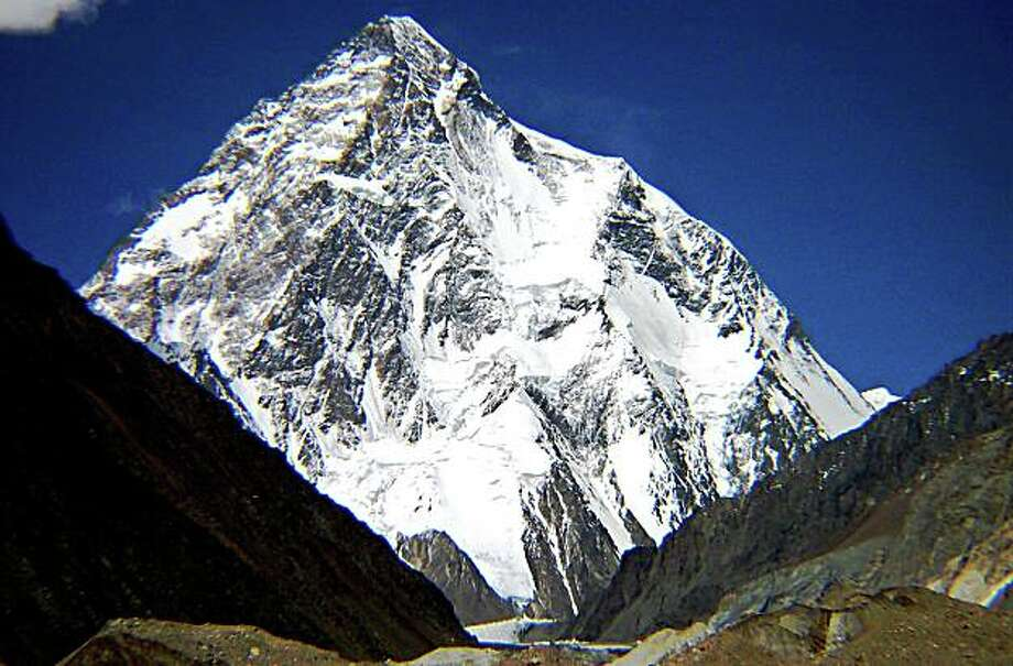 "This undated file handout picture shows the world second highest peak K2 standing at the Himalayan Karakoram Range in the northern area of Pakistan.  At least seven climbers have died in northern Pakistan after scaling the 8,611-metre K2 peak in the Himalayas, an expedition official said on August 3, 2008.  A big piece of ice fell on the climbers while they were descending from K2's Summit on Friday at the ""Bottleneck"" portion of the mountain from where they had to pass via ropes, Akram said.   AFP PHOTO/PAKISTAN TOURISM DEVELOPMENT CORPORATION/HO/FILES (Photo credit should read HO/AFP/Getty Images) Photo: HO, AFP/Getty Images"