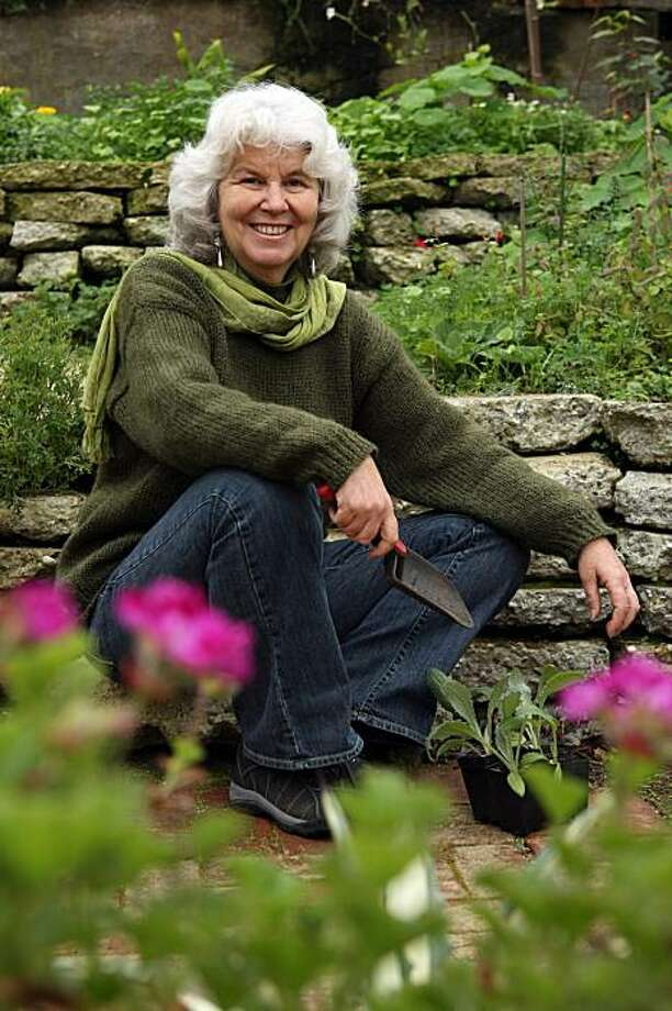 Pam Pierce, horticulturist and author of Golden Gate Gardening: The Complete Guide to Year-Round Food Gardening in the San Francisco Bay Area and Coastal California, sits in her back yard garden Friday, January 15, 2010. Photo: Erin Lubin, Special To The Chronicle