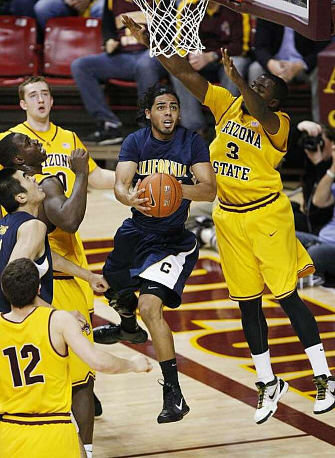 Arizona State's Ty Abbott, right, pressures California's Jorge Gutierrez under the basket during an NCAA college basketball game in Tempe, Ariz., Thursday, Jan. 28, 2010. Photo: Rob Schumacher, AP