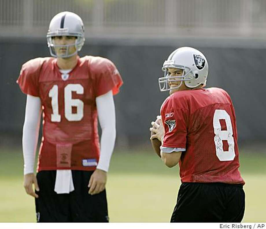 Oakland Raiders backup quarterbacks Marques Tuiasosopo, right, and Andrew Walter, left, take turns throwing during workouts at their football training camp in Napa, Calif., Friday, July 25, 2008. Photo: Eric Risberg, AP