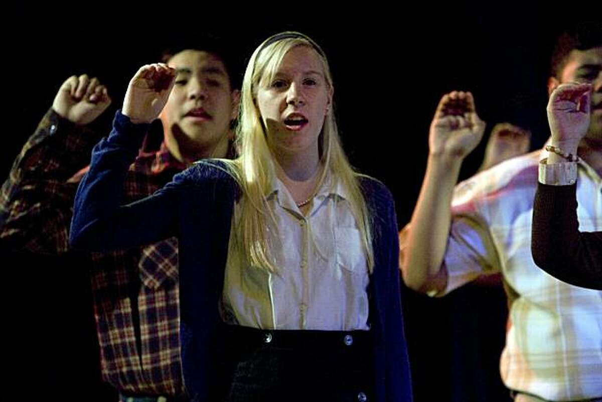 Hailey Scandrette, center, performs as Alene during The Marsh Teen Troupe's dress rehearsal of 'The Wave', on Monday, Jan. 25, 2010 in San Francisco, Calif. at the Marsh. Ron Jones wrote the musical based on an experiment in fascism he conducted at a Palo Alto high school in the mid-1960s.
