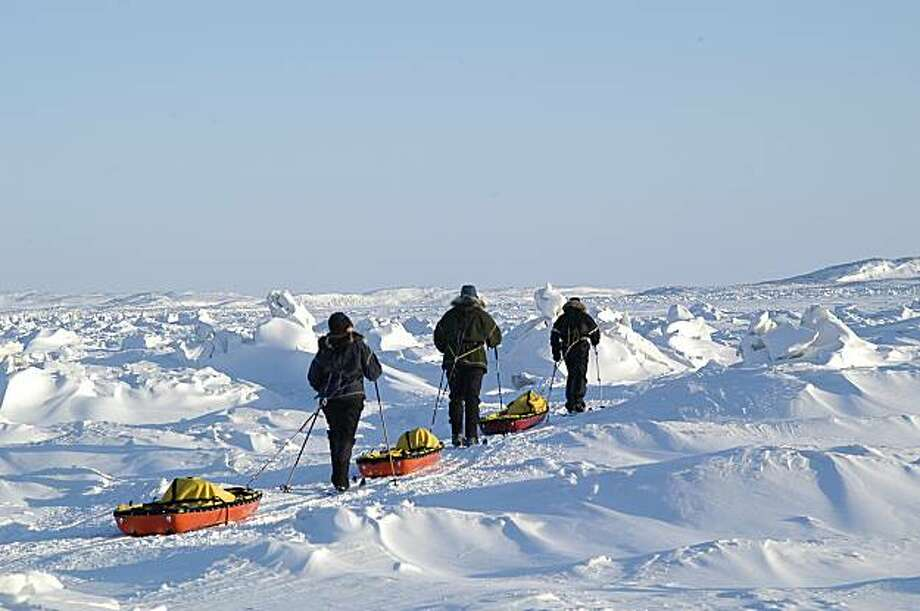 The group sets off on a training run across Frobisher Bay with empty pulks. Photo: Margo Pfeiff, Special To The Chronicle
