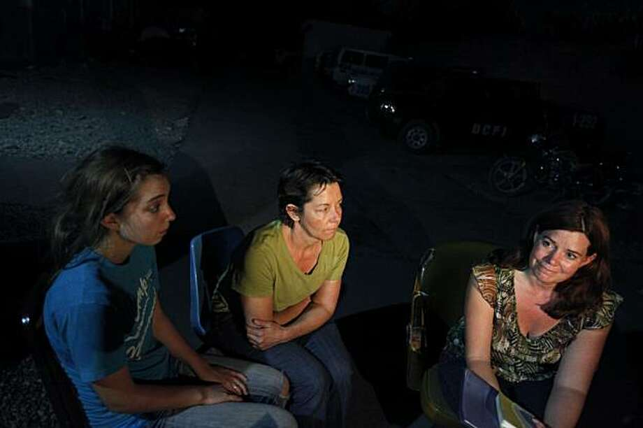 American citizen Laura Silsby, 40, of Boise, Idaho, right, speaks as Nicole Lark Ford, 18, of Middleton, Idaho, left, and Carla Thompson, 53, of Meridien, Idaho, center, look on during an interview with the Associated Press at police headquarters at the international airport in Port-au-Prince, Saturday, Jan. 30, 2010. Ten Americans were detained by Haitian police on Saturday as they tried to bus 33 children across the border into the Dominican Republic, allegedly without proper documents. Photo: Ramon Espinosa, AP