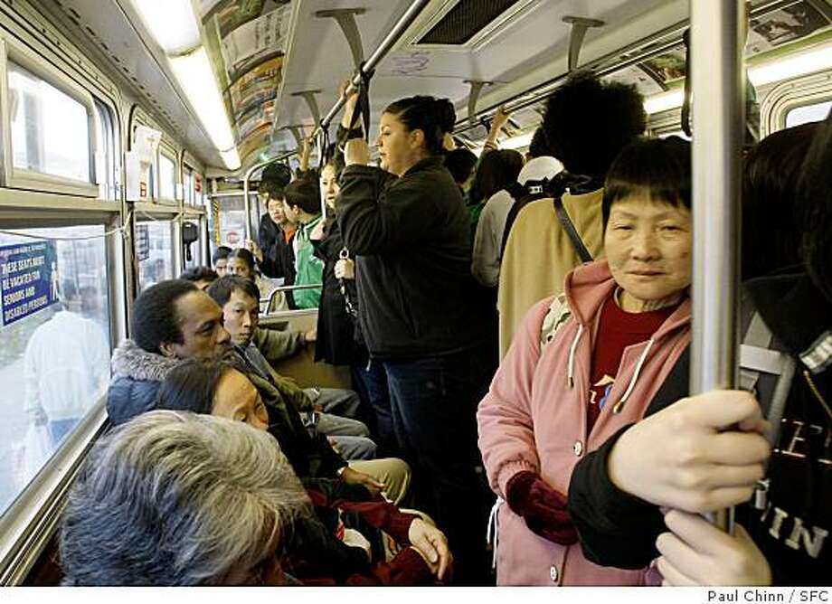 Commuters squeeze into the aisle of a 44-O'Shaughnessy Muni bus in San Francisco, Calif. on Friday, Feb. 15, 2008.Photo by Paul Chinn/San Francisco Chronicle Photo: Paul Chinn, SFC