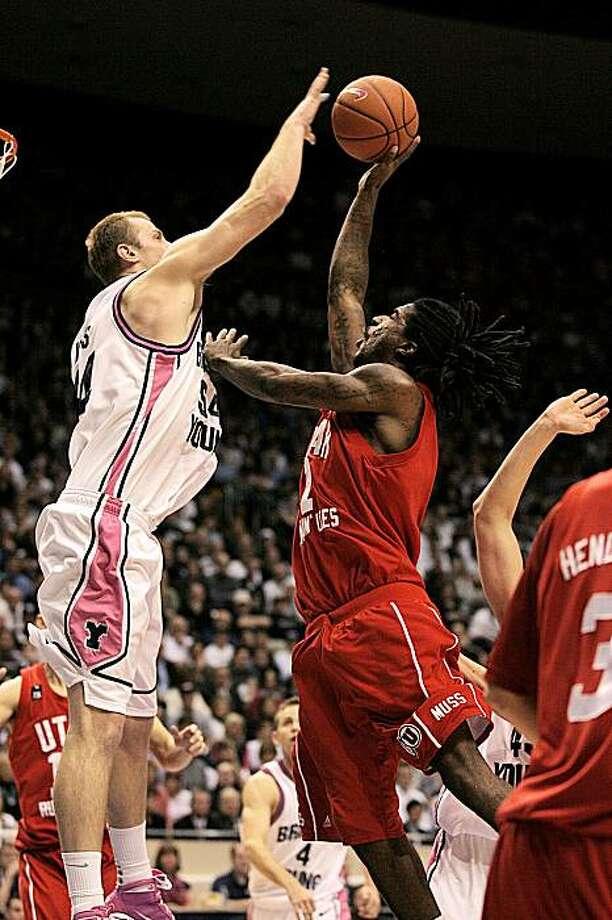 Utah's Jay Watkins (1) draws the foul on BYU's Chris Miles (54) during an NCAA college basketball game on Saturday, Jan. 30, 2010, in Provo, Utah. Photo: Mark Johnston, AP