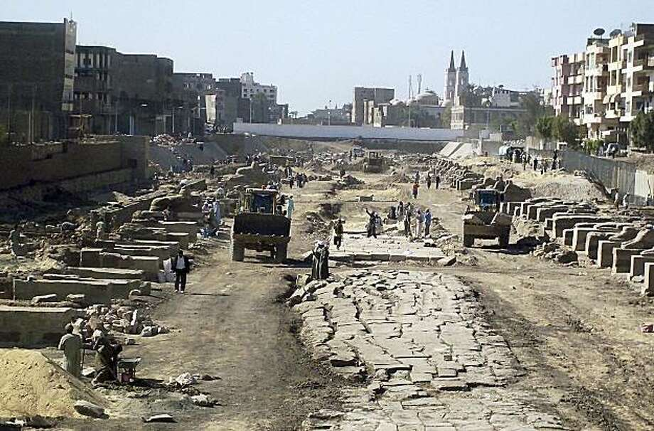 """Egyptian workers in Luxor, Egypt, restore the Alley of Sphinxes, Sunday, Jan. 24, 2010, known as  the """"Kebash Road"""", which was originally lined with 1,200 sphinxes and was built by Amenhotep III in the 12th century B.C .Luxor is set to become the world'slargest open-air museum as a multi-million dollar project to restore the Alley of Sphinxes begins in the south of Egypt, said the governor of Luxor Sunday. Photo: Saedi Press, AP"""