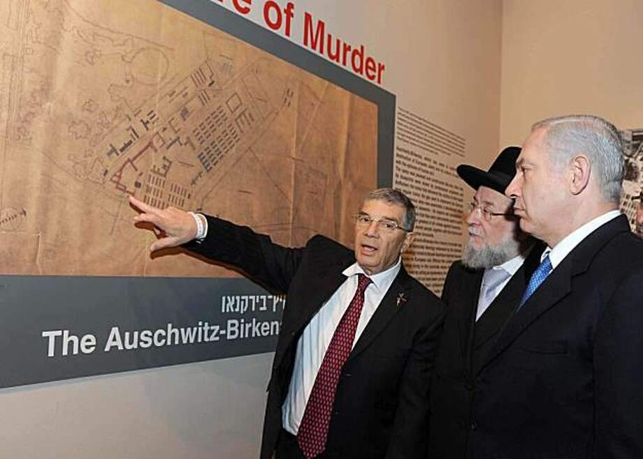A handout picture released by Israel's Government Press Office shows Israeli Prime Minister Benjamin NetanyahU at the opening of an exhibit of the Auschwitz death camp at Yad Vashem holocaust memorial in Jerusalem on January 25, 2010. Netanyahu inaugurated an exhibition of the Auschwitz death camp blueprints saying Jews are again facing calls for their extermination, an apparent reference to Iran.. Photo: -, AFP/Getty Images