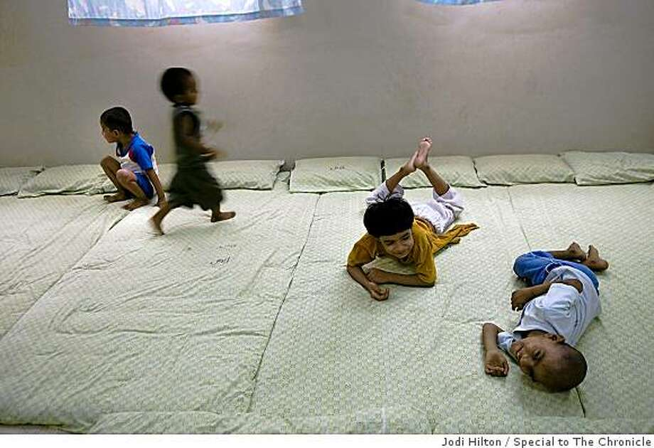 Orphans play during the afternoon at the headquarters of the Edhi Foundation in Karachi on June 19, 2008.  Photo by Jodi Hilton / Special to The Chronicle Photo: Jodi Hilton, Special To The Chronicle