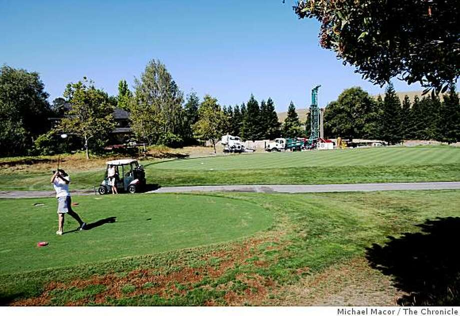 Golfers at Blackhawk Country Club in Danville, Calif., Wednesday July 23, 2008, have a little to contend with as a water well drilling rig digs close to the tee box. Drilling for water currently down to depth of 600 feet with plans on going to 1,000 feet in search for a strong water supply. Photo: Michael Macor, The Chronicle