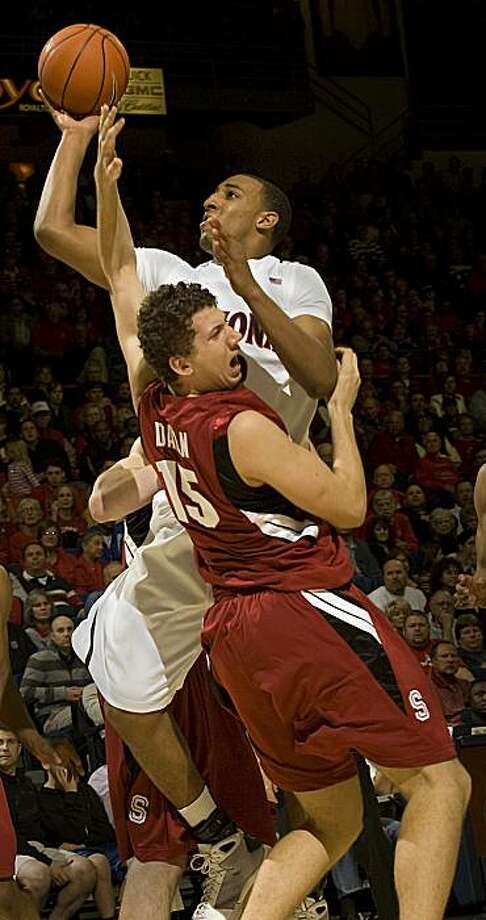 Arizona's Derrick Williams, top, shoots over the attempted defense of Stanford's Matei Daian (15) in the second half of an NCAA college basketball game at McKale Center in Tucson, Ariz., Thursday, Jan. 28, 2010. Arizona won, 76-68. Photo: Wily Low, AP