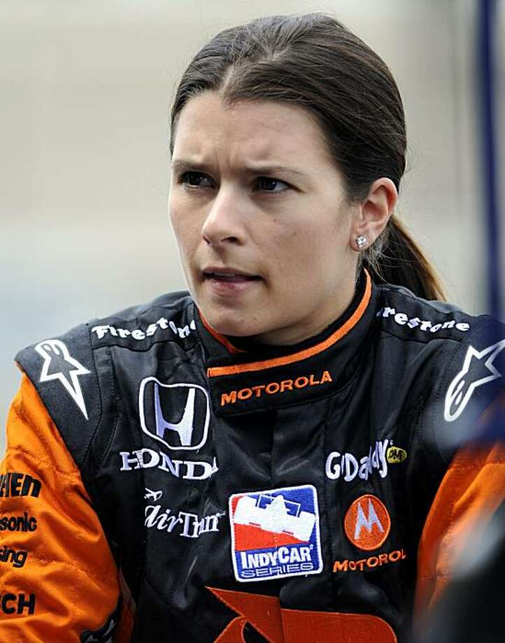 Driver Danica Patrick talks with her crew on pit road during practice for the Honda Indy 200 auto race at Mid Ohio Sports Car Course, Friday, Aug. 7, 2009, in Lexington, Ohio. (AP Photo/Tom E. Puskar) Photo: Tom Puskar, AP