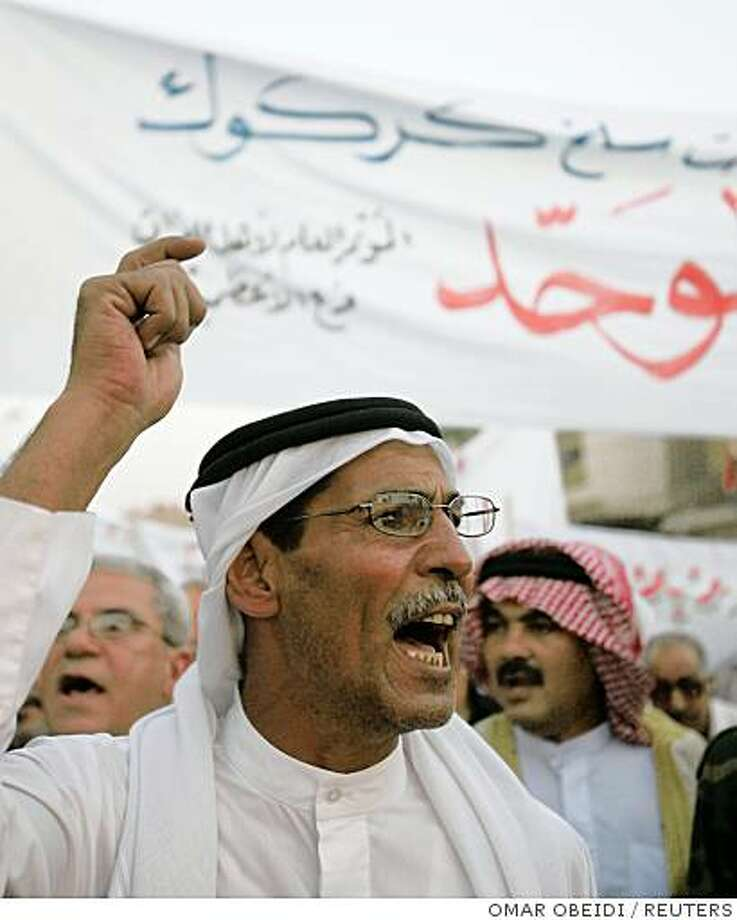 A demonstrator chants slogans during a protest in Baghdad's Adhamiya district August 4, 2008. Hundreds people took to the streets supporting the passage of the provincial council elections law, which includes an article postponing Kirkuk's elections. REUTERS/Omar Obeidi (IRAQ) Photo: OMAR OBEIDI, REUTERS