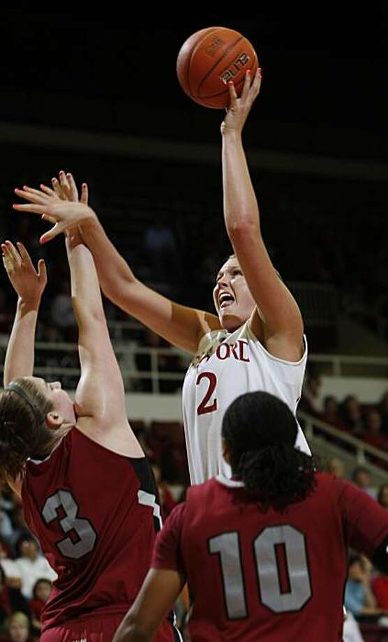 Stanford forward Jayne Appel (2) scores over Washington State center Katie Madison (3) and guard Danielle LeNoir (10) in the second half of an NCAA college basketball game in Stanford, Calif., Thursday, Jan. 14, 2010. Stanford defeated Washington State 80-43. Photo: Paul Sakuma, AP