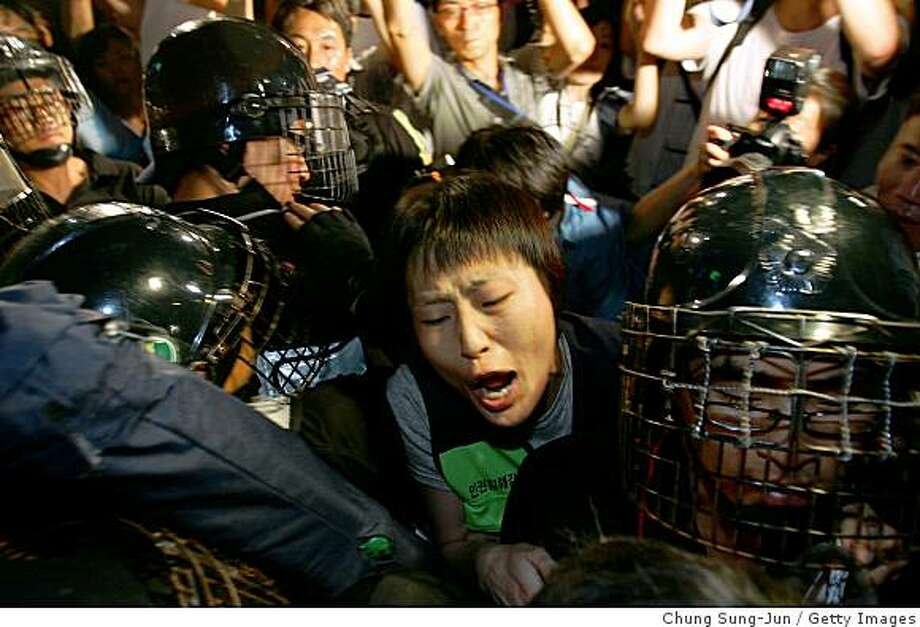 SEOUL, SOUTH KOREA - AUGUST 05:  Protesters clash with police during a rally against U.S. President George W. Bush's visit on August 5, 2008, in Seoul, South Korea. Bush is on an Asian tour visiting South Korea and Thailand before attending the 2008 Beijing Olympic Games Opening Ceremony.  (Photo by Chung Sung-Jun/Getty Images) Photo: Getty Images