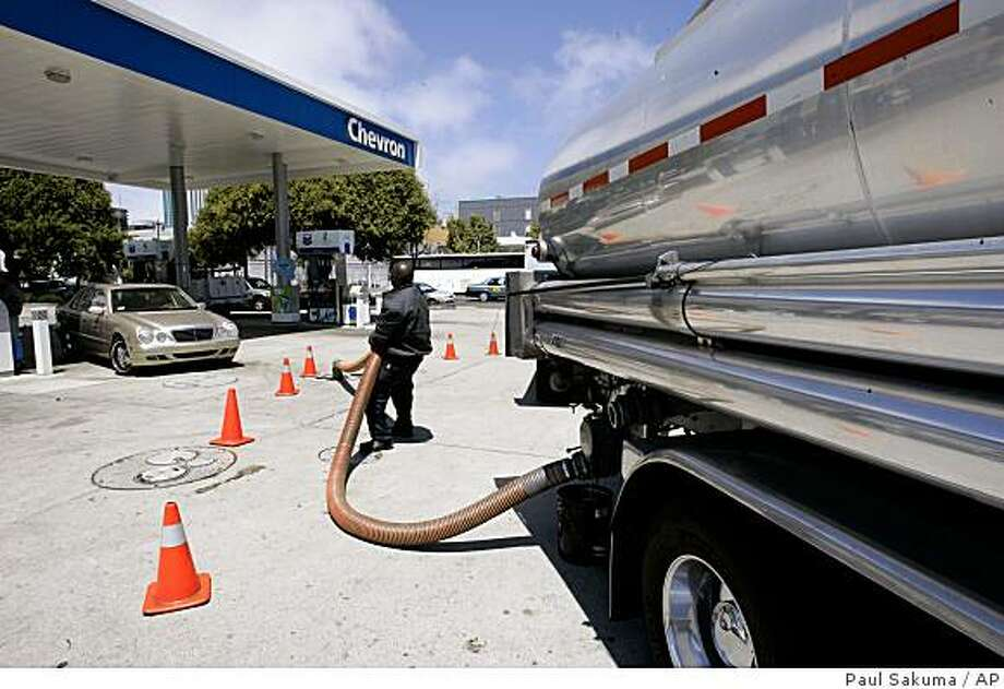 A worker empties gas from his tanker truck at a Chevron gas station in San Francisco, Monday, Aug. 4, 2008.  Oil prices plunged to a three-month low Monday, briefly tumbling below $120 a barrel in another huge sell-off after Tropical Storm Edouard seemed less likely to disrupt oil and natural gas output in the Gulf of Mexico.(AP Photo/Paul Sakuma) Photo: Paul Sakuma, AP