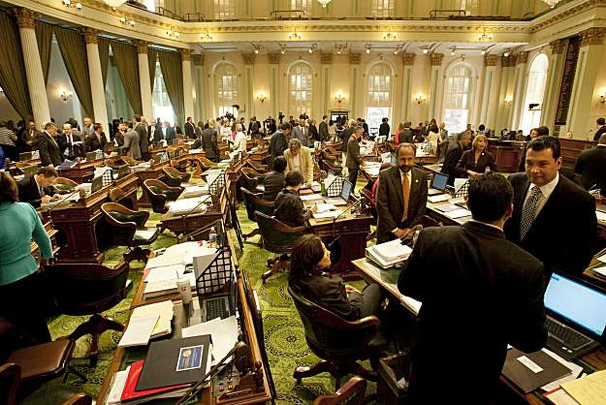 The combined state Senate and Assembly gather in the Assembly chambers after hearing Governor Arnold Schwarzenegger tell them they need to speed through a solution to the $24.3 billion deficit in Sacramento June 2, 2009. The state's budget crisis looks to be a major campaign issue next year as California voters sort through a crowded field of gubernatorial candidates.