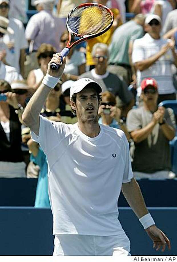 Andy Murray, from Great Britain, waves to the crowd after defeating Ivo Karlovic, from Croatia, 6-4, 6-4, in a semifinal match at the Western & Southern Financial Group Masters tennis tournament, Saturday, Aug. 2, 2008, in Mason, Ohio. (AP Photo/Al Behrman) Photo: Al Behrman, AP