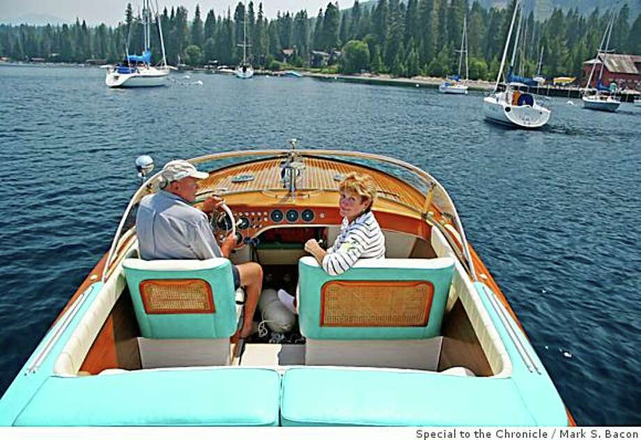 Bill and Mary Jo Shepard cruise into shore  at Lake Tahoe in their Riva Aquarama, a 1969 vintage mahogany runabout. They'll be showing one of ther other boats at the Concours d'Elegance at Carnelian Bay at Lake Tahoe Aug. 7-9, 2008. Photo: Special To The Chronicle, Mark S. Bacon