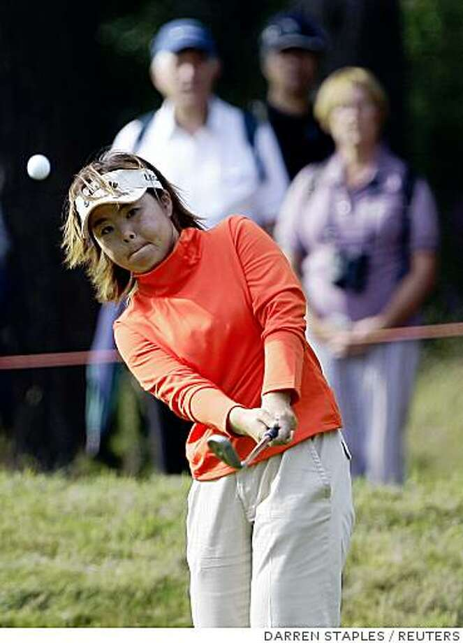 Japan's Yuri Fudoh chips onto the 14th green during the third round of the Women's British Open golf tournament at  Sunningdale, southeast England August 2, 2008.   REUTERS/Darren Staples (BRITAIN) Photo: DARREN STAPLES, REUTERS