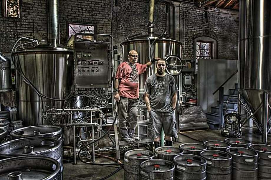 "Owner/head brewer Adam Lamoreaux (right) and assistant Fraggle inside the Linden Street Brewery, where the ""Winter Brews Festival"" will be held this Saturday. Photo: Pat Sklenar"