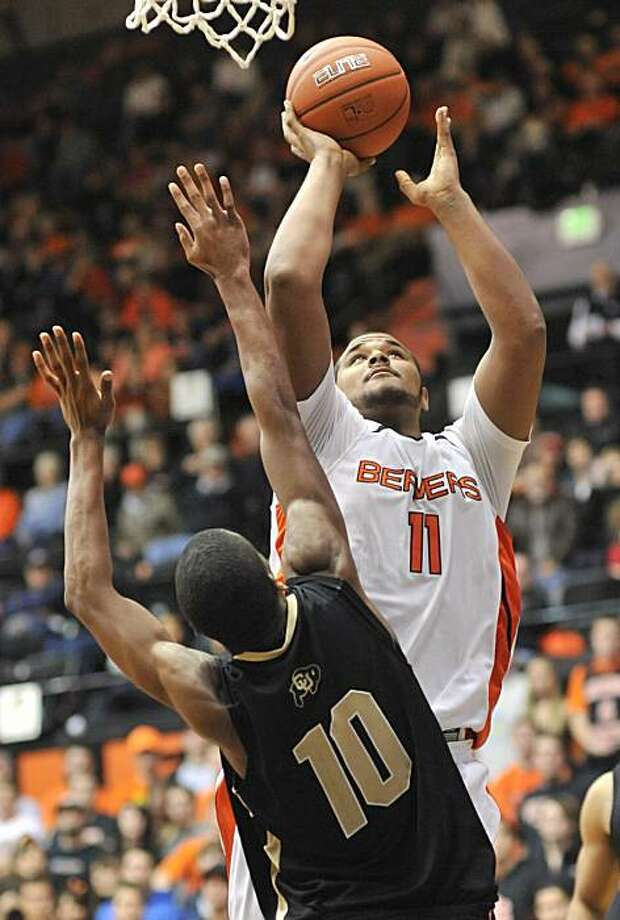 Oregon State University's Joe Burton goes up for a bucket in the 74-69  win against Colorado University on December 4 in Corvallis, Ore.  (Scobel Wiggins | Gazette-Times) Photo: Scobel Wiggins, Corvallis Gazette-Times