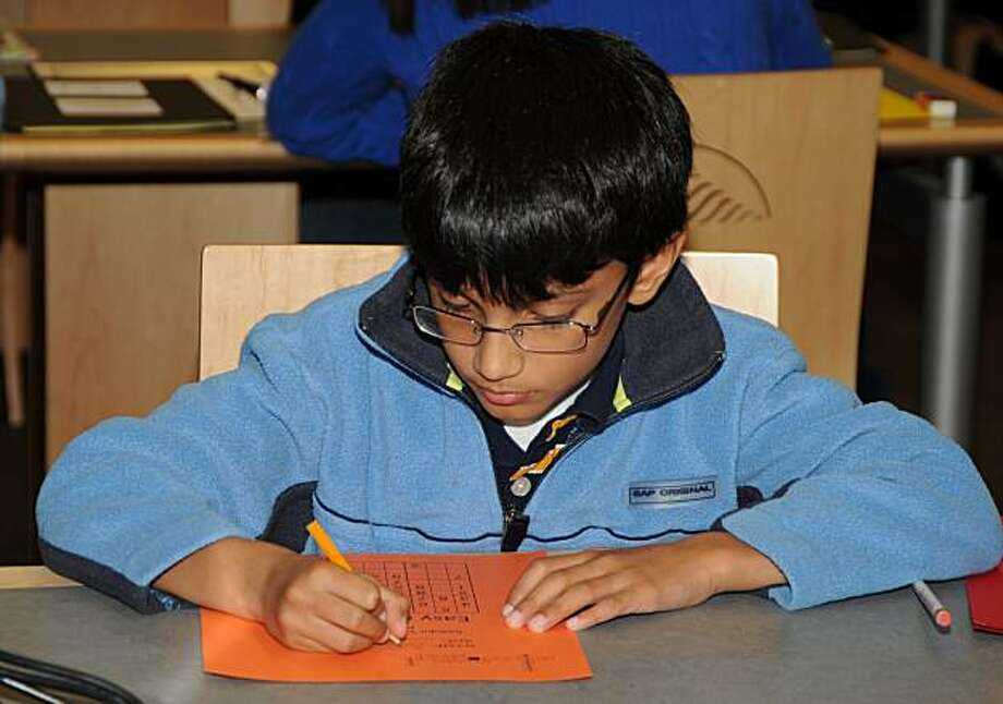 During Silicon Valley Puzzle Day, kids can try their hands at both crossword puzzles and Sudoku. Photo: Sue Brazelton