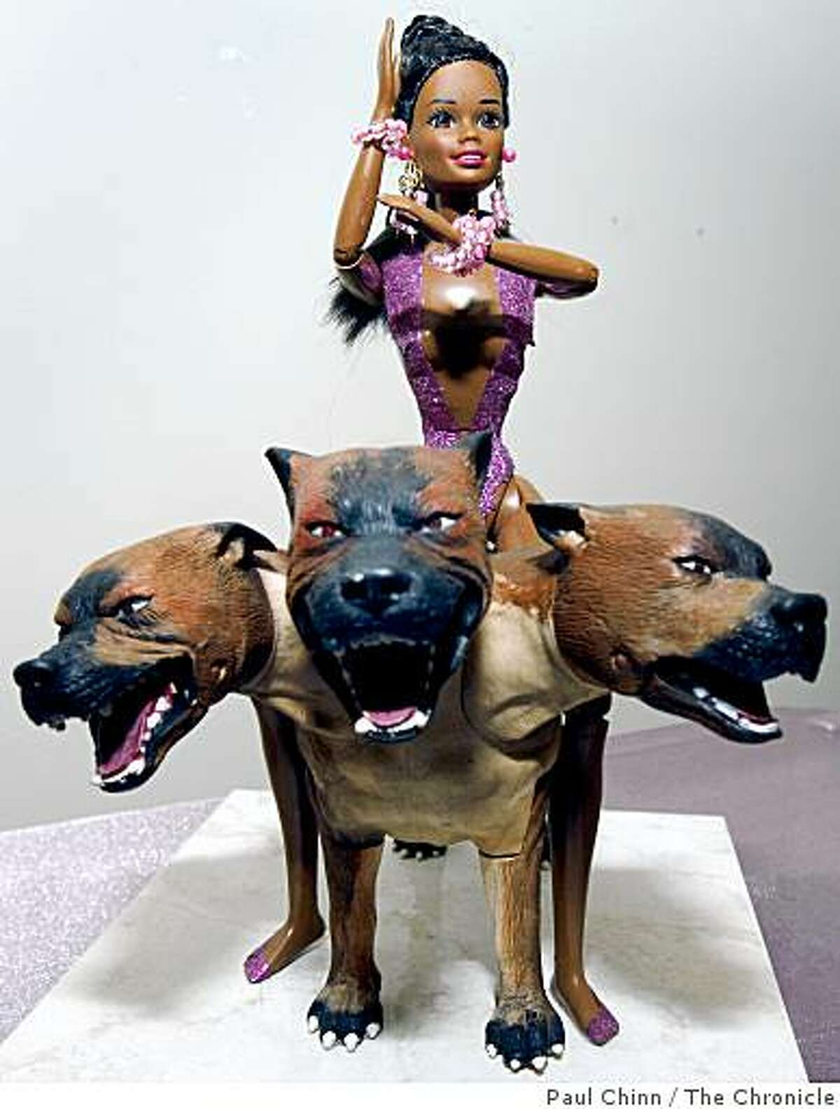 """""""Barbie on a Three-Headed Pit Bull"""" by artist LaVonne Sallee is displayed in the Altered Barbie art show at Gallery 94124 in San Francisco, Calif., on Wednesday, July 23, 2008. The show runs through August 17.Photo by Paul Chinn / The Chronicle"""