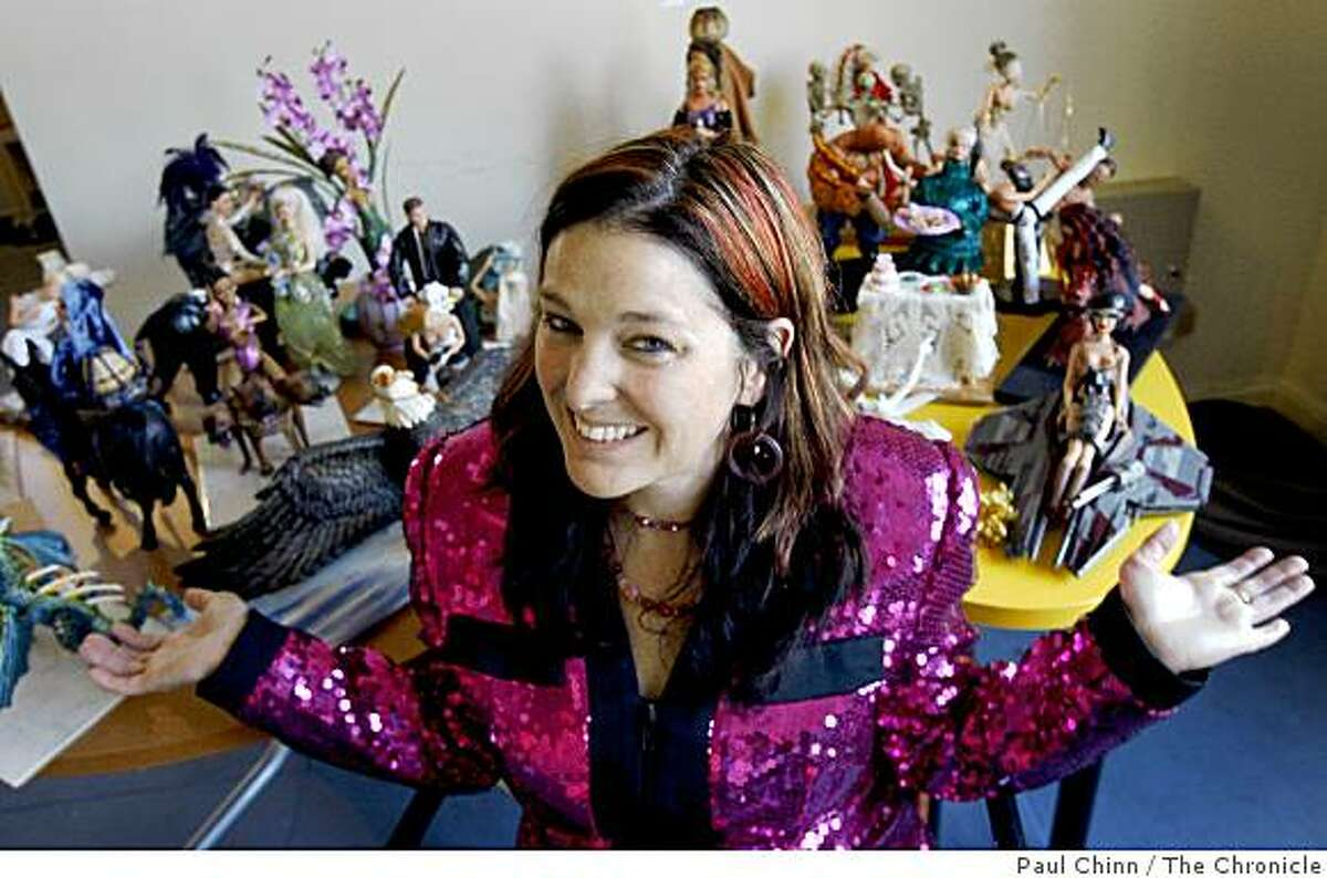 Julie Andersen, curator of the Altered Barbie exhibition, sits with pieces created by artist LaVonne Sallee at Gallery 94124 in San Francisco, Calif., on Wednesday, July 23, 2008. The show runs through August 17.Photo by Paul Chinn / The Chronicle