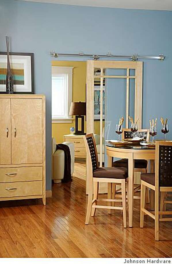 Johnson Hardware's wall-mounted hardware allows doors to slide rather than open out. Photo: Johnson Hardware