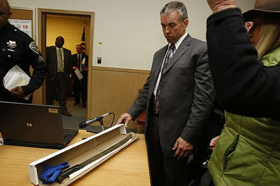 A press conference was held at the Hall of Justice in San Francisco, Ca., on Monday, January 25, 2010, where investigator Daniel Cunningham shows the machete that 65-year-old Edward Smith was wielding outside his home when he was shot by a police officer last Saturday. Photo: Liz Hafalia, The Chronicle