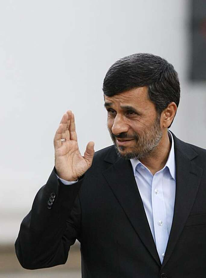 Iranian President Mahmoud Ahmadinejad wave as he arrives at the presidency, in Tehran, Iran, Wednesday, Jan. 20, 2010. Iran has told the head of the U.N. nuclear agency that it does not accept an international proposal committing it to quickly export mostof the material it would need to make a nuclear warhead Photo: Vahid Salemi, AP