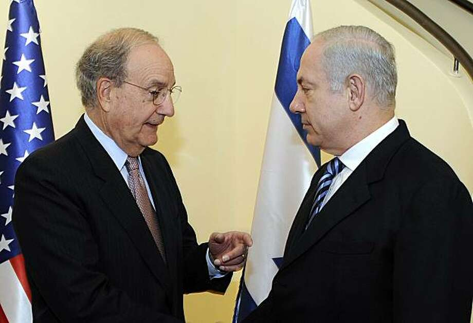 In this photo made available by the U.S. Embassy to Israel, U.S. Middle East envoy, George Mitchell, left, meets Israeli Prime Minister Benjamin Netanyahu in Jerusalem, Sunday, Jan. 24, 2010.  Mitchell pressed on with his sputtering, year-old peace mission Sunday, shuttling between the Israeli and Palestinian leaders in an effort to break a stubborn deadlock over Israeli settlement construction. Photo: Matty Stern, AP