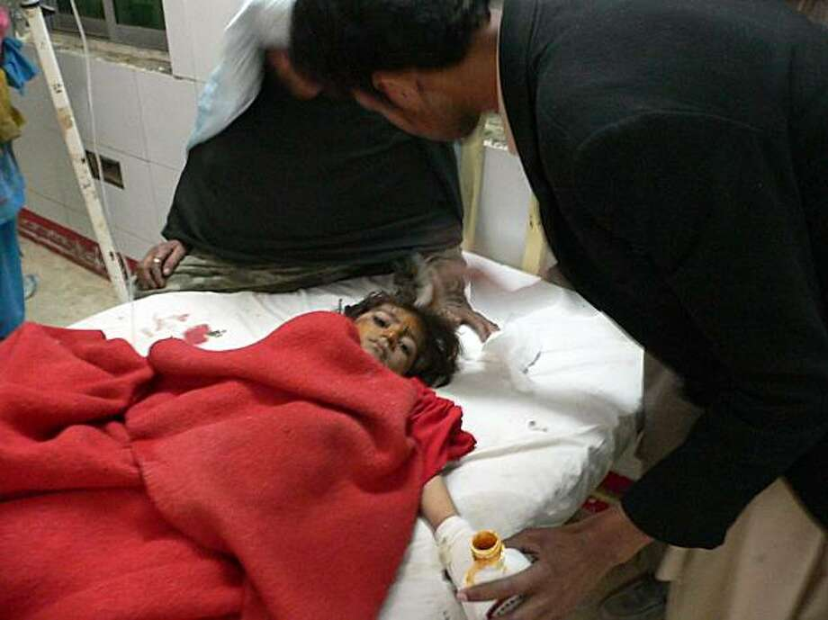A Pakistani paramedic staff member gives treatment to an injured girl at a hospital after a suicide car bomb attack in Dera Ismail Khan on January 23, 2010. A suicide car bomb attack killed at least four people in a town in troubled northwest Pakistan onJanuary 23, police said. The attack took place close to a police station in Gomal, 25 kilometres (15 miles) south of the city of Tank, neighbouring the Taliban stronghold of South Waziristan where Pakistani troops are battling Islamist militants. Photo: Naseer Azam, AFP/Getty Images