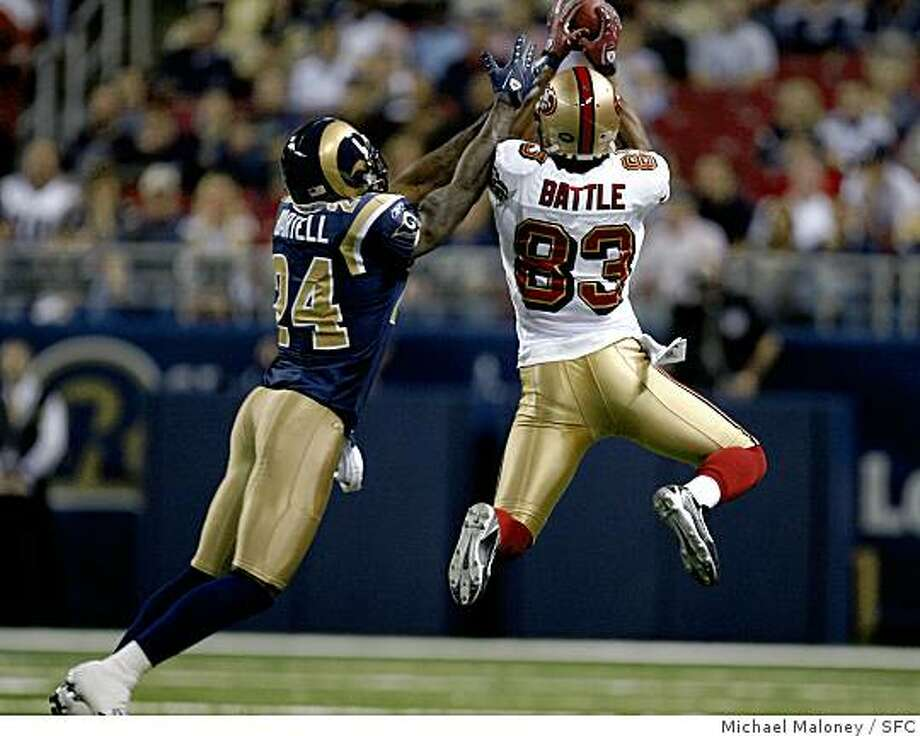 : San Francisco 49ers Arnaz Battle (#83) just misses catching this 1st quarter pass from quarterback Alex Smith in the 1st quarter. St Louis Rams Ron Bartell (#24) covering.The St Louis Rams host the San Francisco 49ers at Edward Jones Dome on 9/16/07 in St Louis, MO. The SF 49ers won 17-16.Photo by Michael Maloney / San Francisco Chronicle***roster/code replacement San Francisco 49ers Arnaz Battle (#83) just misses catching this 1st quarter pass from quarterback Alex Smith in the 1st quarter. St Louis Rams Ron Bartell (#24) covering. The St Louis Rams host the San Francisco 49ers at Edward Jones Dome on 9/16/07 in St Louis, MO. The SF 49ers won 17-16. Photo by Michael Maloney / San Francisco Chronicle Photo: Michael Maloney, SFC