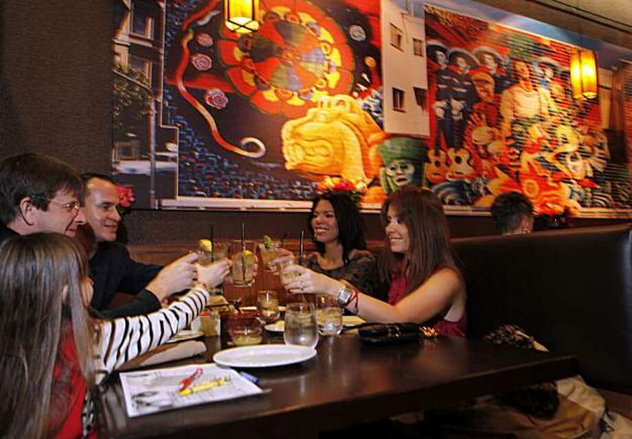 Carlos Santana has opened his fifth restaurant, this one in Danville Calif. Diners at Maria Maria sit under giant murals and painting by Michael V. Rios, some of which have been used as backdrops for Santana concerts. Photo: Lance Iversen, The Chronicle