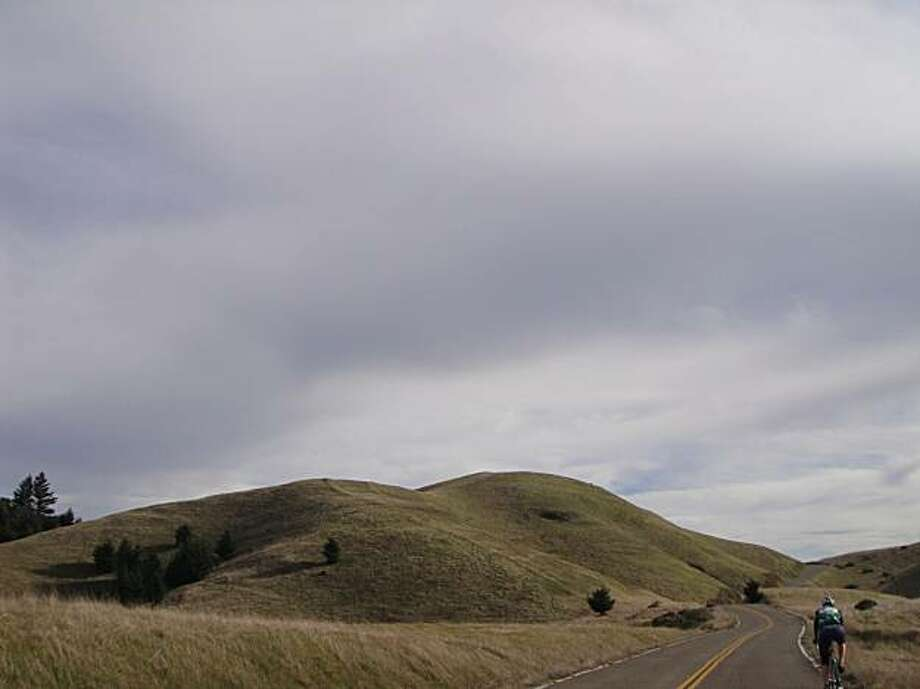 Bicycle riders will enjoy the rolling hills and open roads of the Alpine Dam loop in Marin. Photo: Bradley Koester