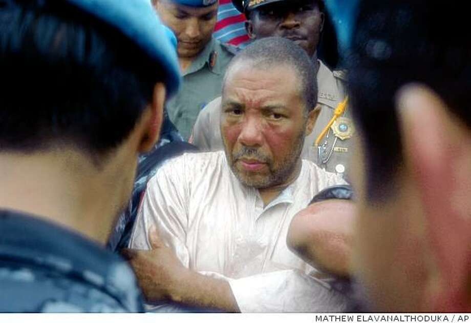 Former Liberian President Charles Taylor, seen here at the airport in Liberia seconds before his arrest on March 29, 2006, was tried in Sierra Leone as a war criminal. Photo: MATHEW ELAVANALTHODUKA, AP