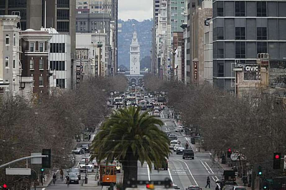 A grand view of Market Street looking towards downtown comes alive near the cross of Laguna Street on Tuesday January 12, 2010 in San Francisco Calif. Photo: Mike Kepka, The Chronicle