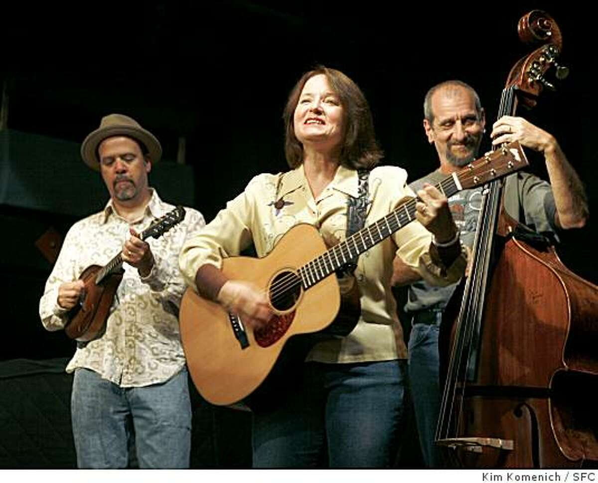Bay Area songwriter and performer Claudia Russell, center, and her band the folk Unlimited Orchestra (Bruce Kaplan on mandolin, left, and Mark Petrella on bass, right ) are photographed at the Freight and Salvage in Berkeley, Calif., on Friday, July 25, 2008. Photo by Kim Komenich / The Chronicle