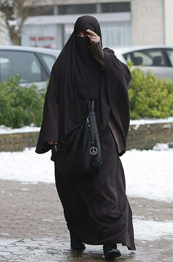 This Jan. 12, 2010 photo shows Faiza Silmi, a 32-year-old Moroccan, walking in Le Mesnil-Saint-Denis, 38 kilometers (24 miles) southwest of Paris. A French parliamentary panel will recommend Tuesday a ban on face-covering Muslim veils in public areas fromhospitals to schools but will stop short of pressing for the garb to be outlawed in the street, the panel's president says. Photo: Christophe Ena, AP